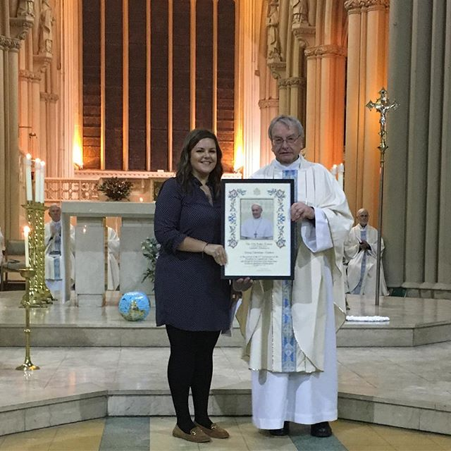 Kate and Fr John receive the papal blessing, presented by Bishop John on Saturday during mass