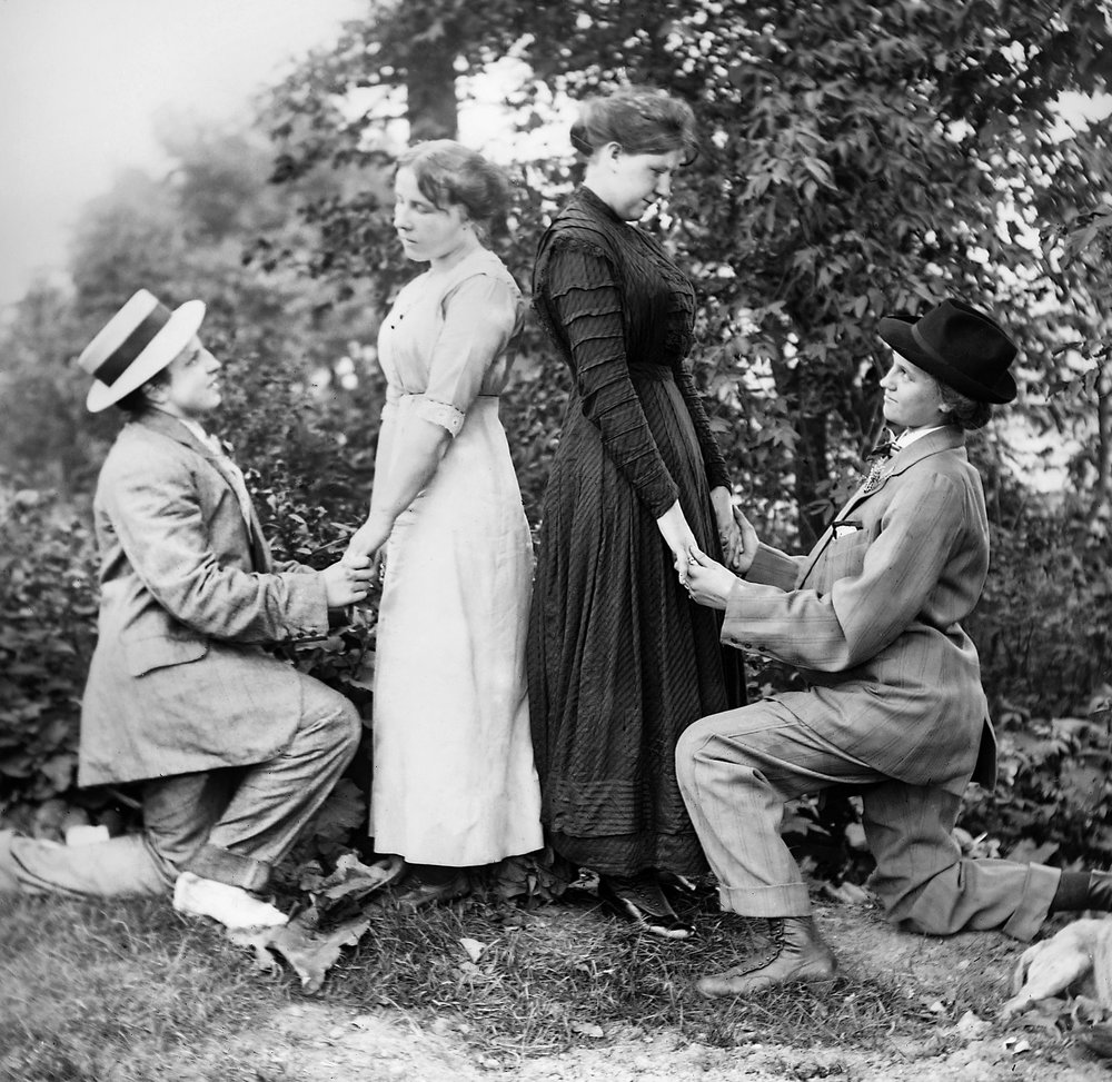 Two couples stage a double wedding proposal in 1912.  Kirn Vintage Stock / Getty Images