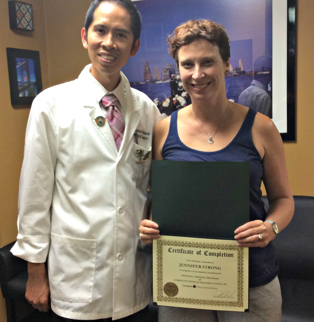 physical therapist dr. james with jersey city physical therapy patient jennifer.jpg