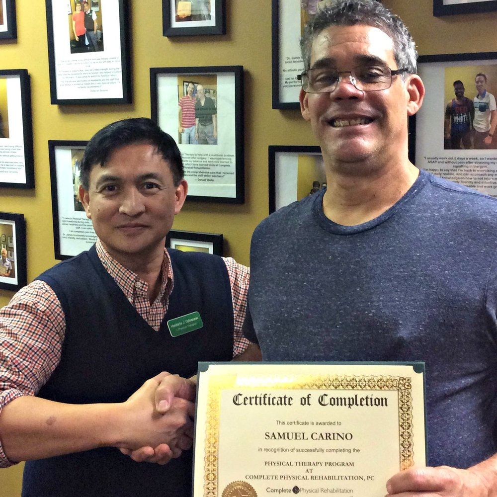 Jersey City Physical Therapist Humberto Colmenares With Samuel