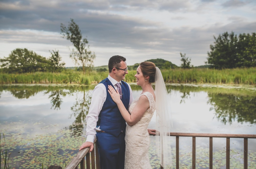 Leicestershire wedding portrait by a lake