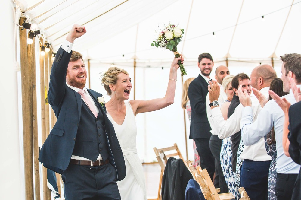 Celebrating newlyweds arrive for their reception, Cotswolds, Gloucestershire
