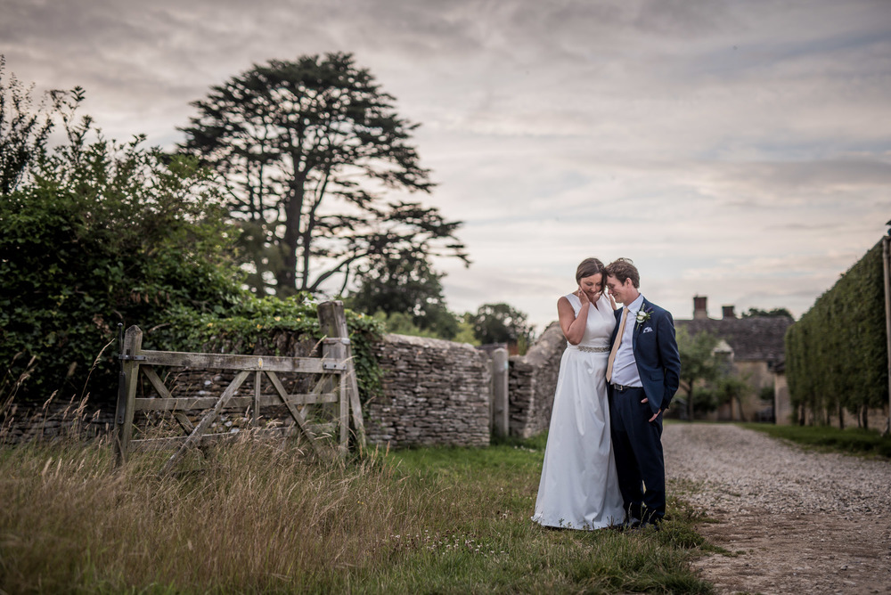 Romantic wedding couple take a moment together during their rustic Cirecenster, Gloucesterhire based wedding