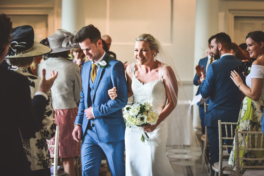 Warwickshire wedding couple walk down the isle
