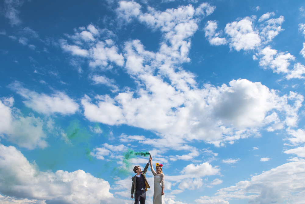 Festival themed wedding with flares on the Devon moors, UK