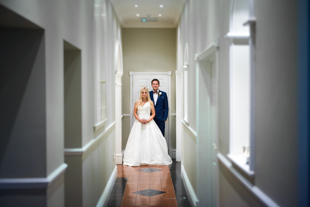 Creative wedding corridor portrait of bride & groom on their wedding day at Blackbrook House, Belper, Derbyshire, UK
