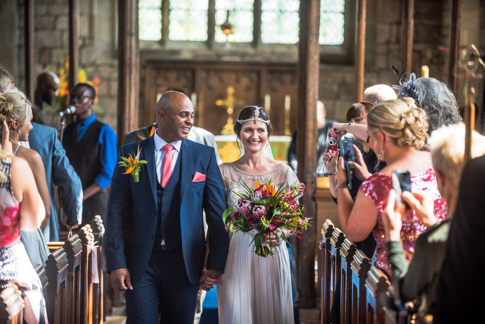 Vintage theme wedding couple walk down the ilse at Holy Trinity Church, Lambley, Nottingham