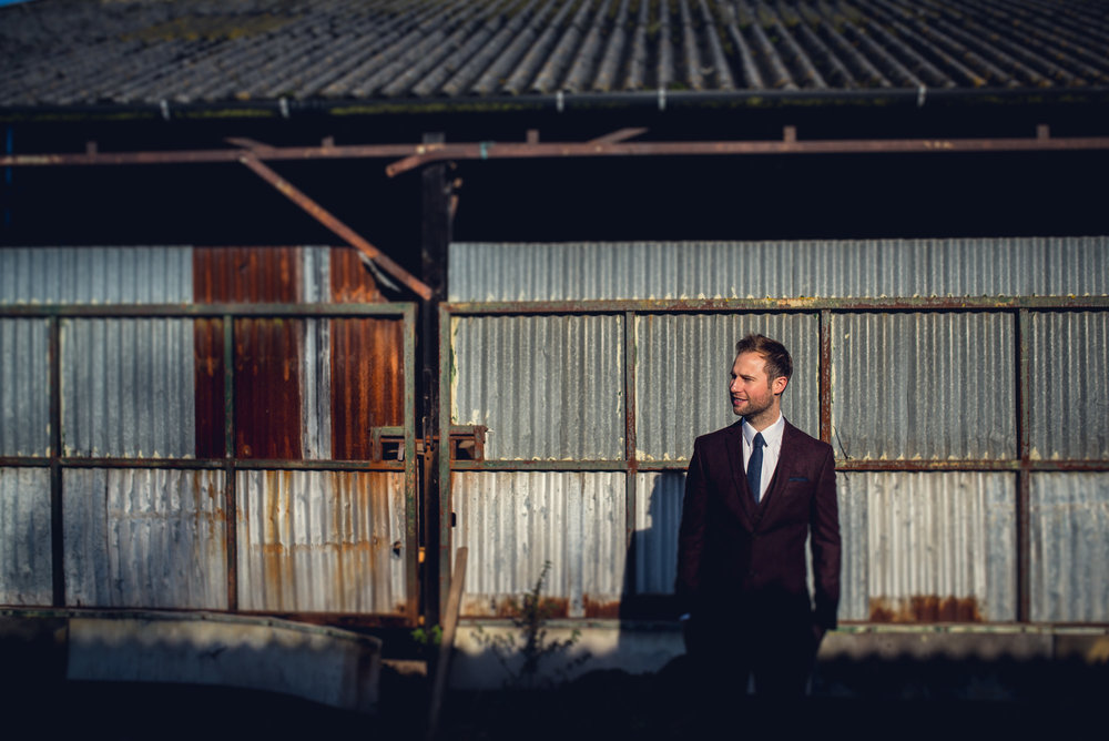 Groom in front of his barn before his rustic Worcestershire wedding