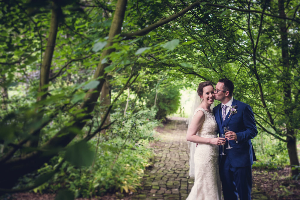 Shropshire wedding couple with champagne