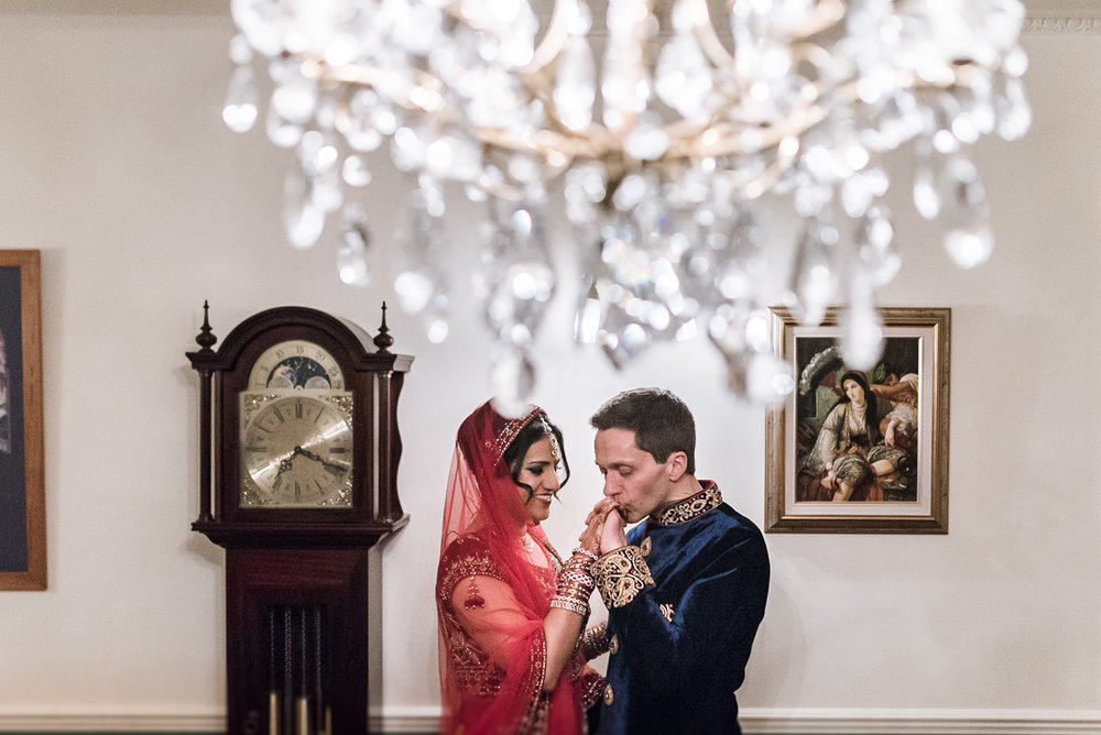 London Indian wedding couple with chandelier r