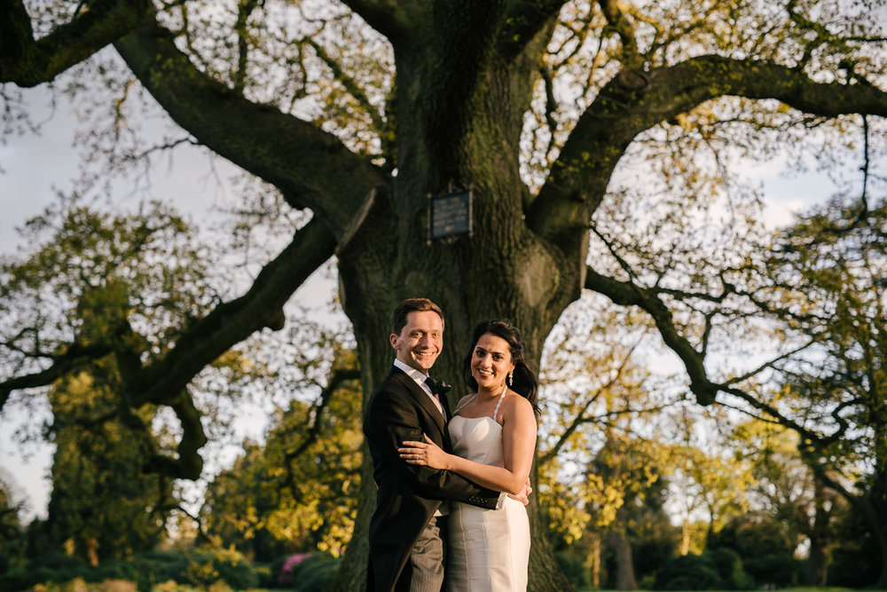 wedding couple in front of a tree at Ashridge house