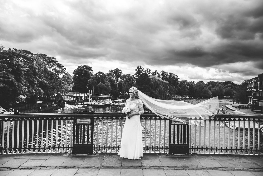 Brides veil caches a gust of wind on Windsor & Eton bridge, Windsor