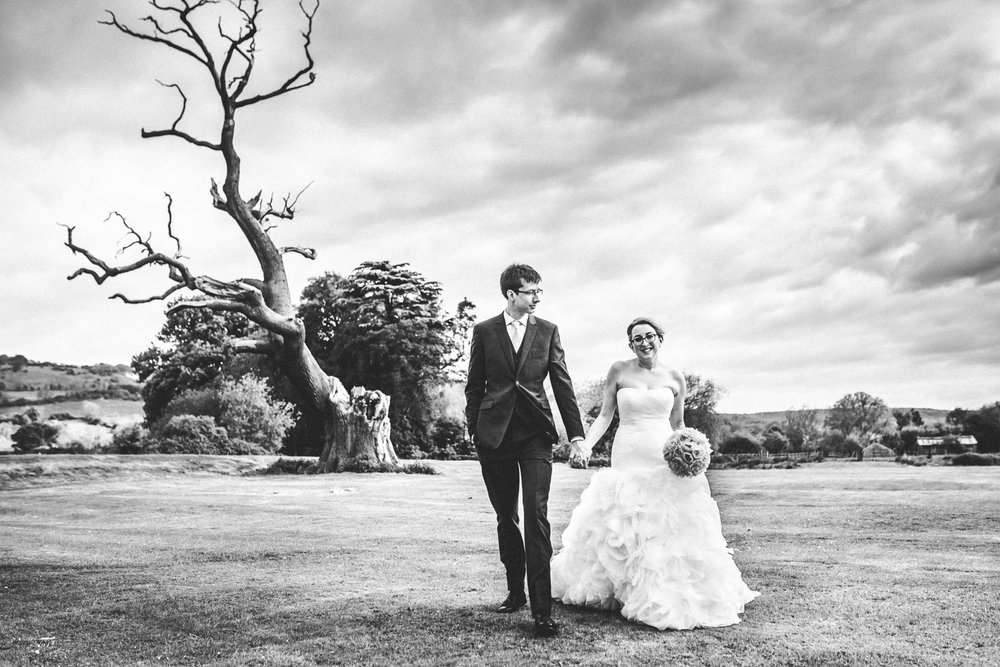 bride and groom enjoy the landscape at the Greenway hotel, Cotswolds, Cheltenham
