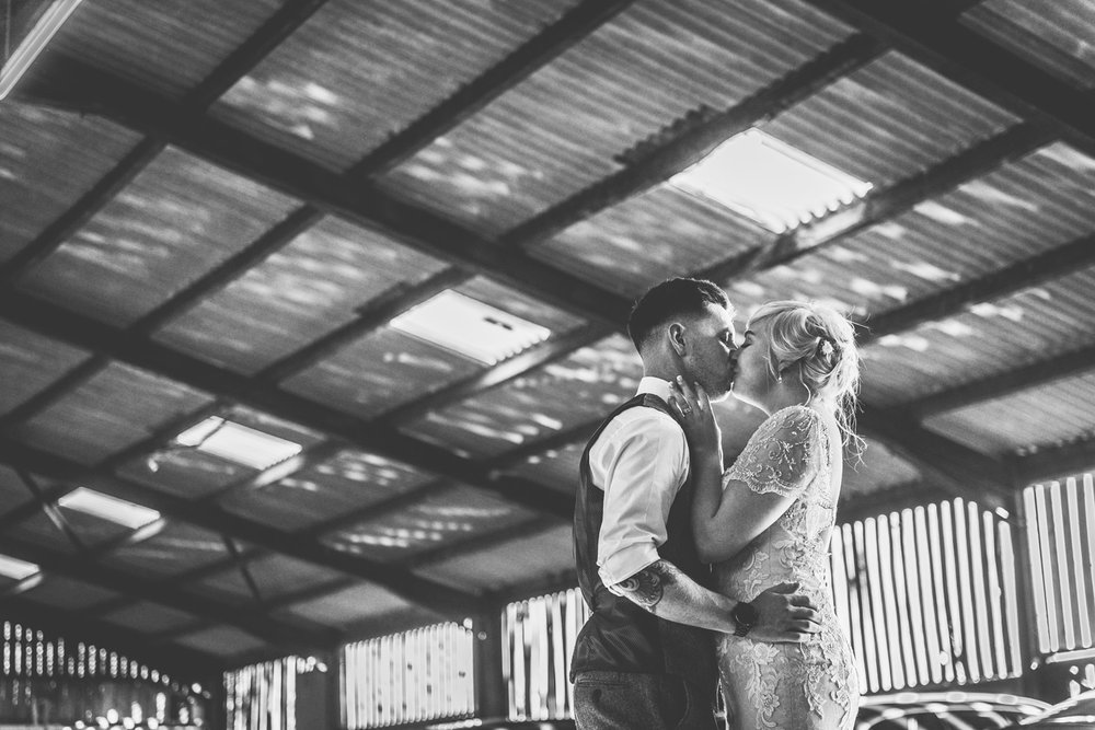 curradine-barns-wedding-kiss.jpg