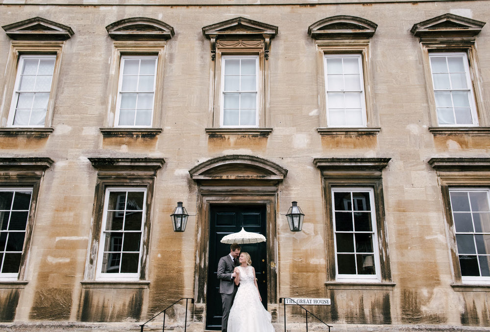 burford wedding couple under an umbrella