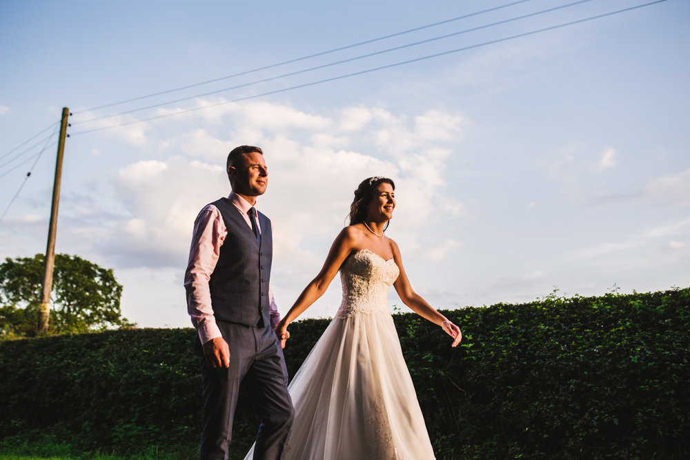 Bride and groom sunset walk in Newport Pagnell