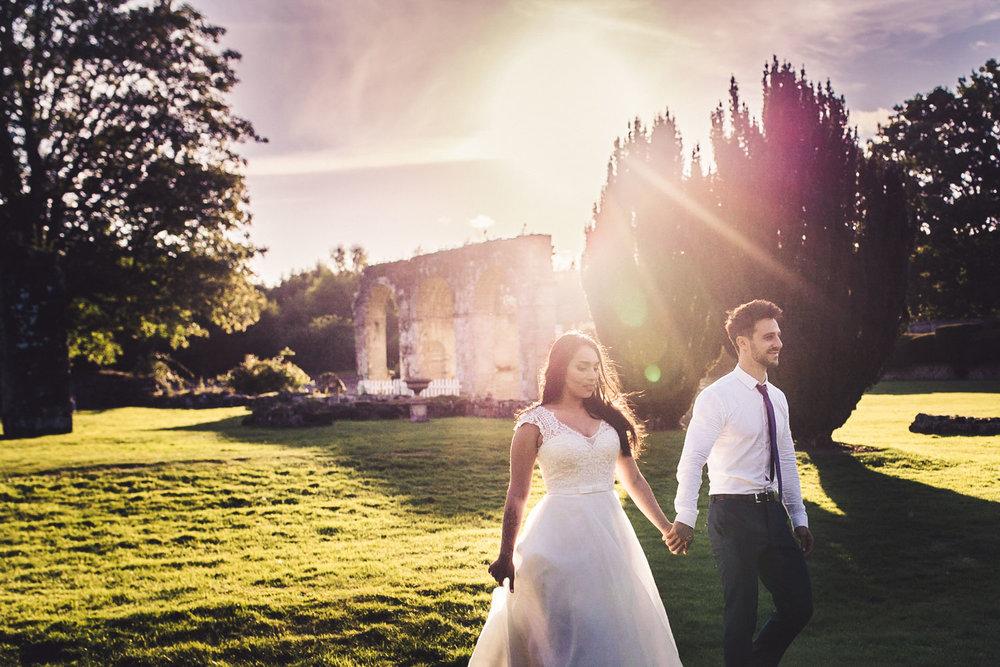 jewish wedding couple enjoy a sunset walk at slaugham place