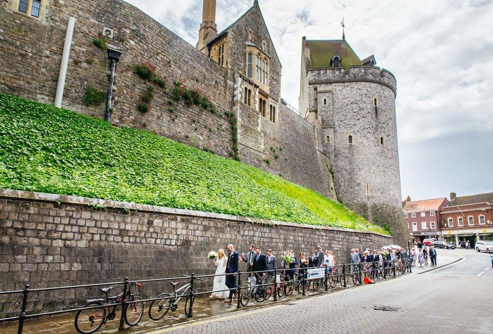 bride-groom-walking-past-windsor-castle.jpg