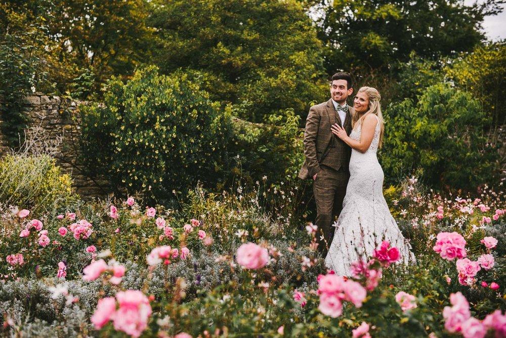 autumn-wedding-pink-flowers-caswell-house.jpg