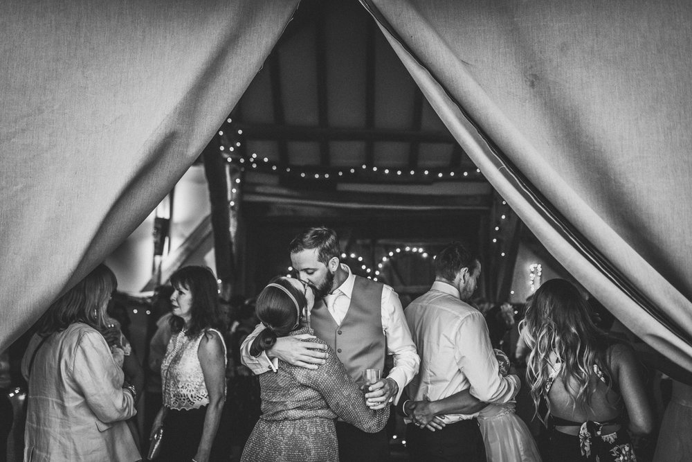 kiss-in-the-tent-dorking-wedding.jpg