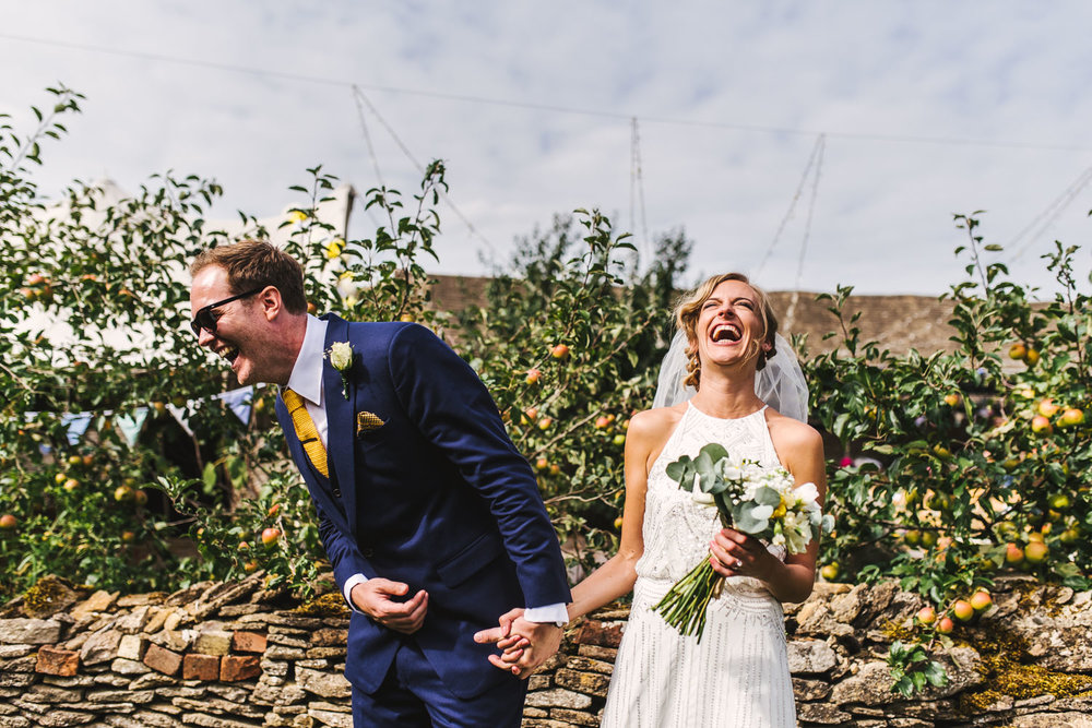 outdoor wedding laughing bride and groom