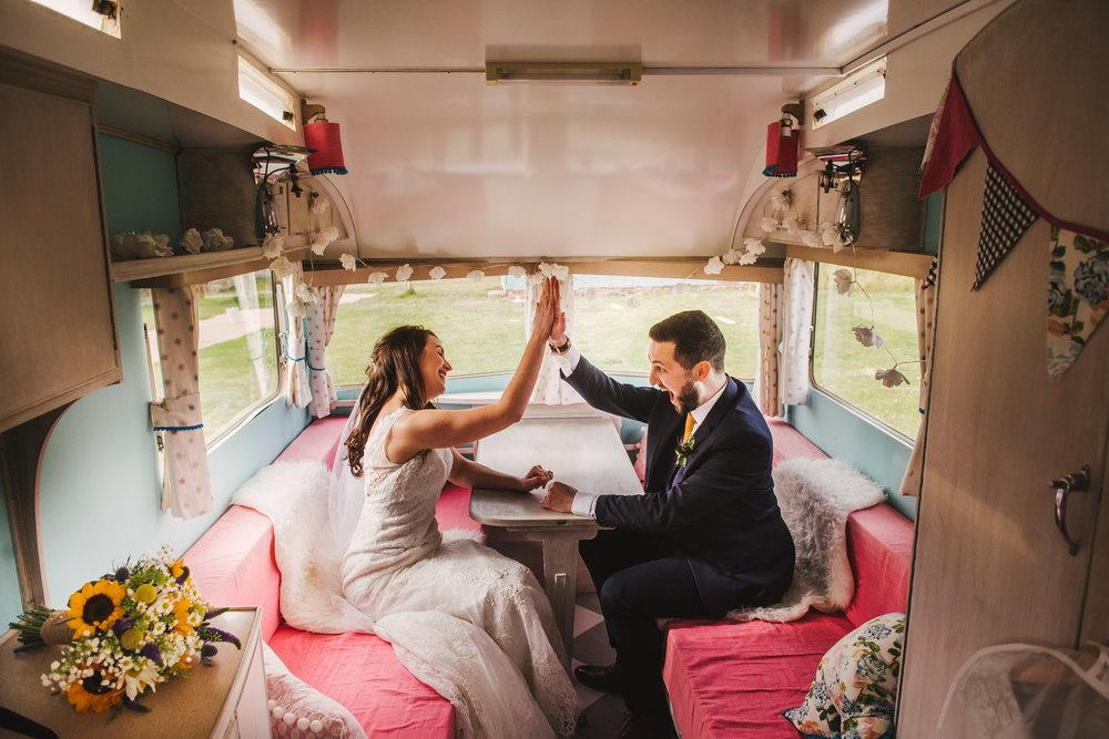 wedding-couple-high-five-in-scarborough-caravan.jpg