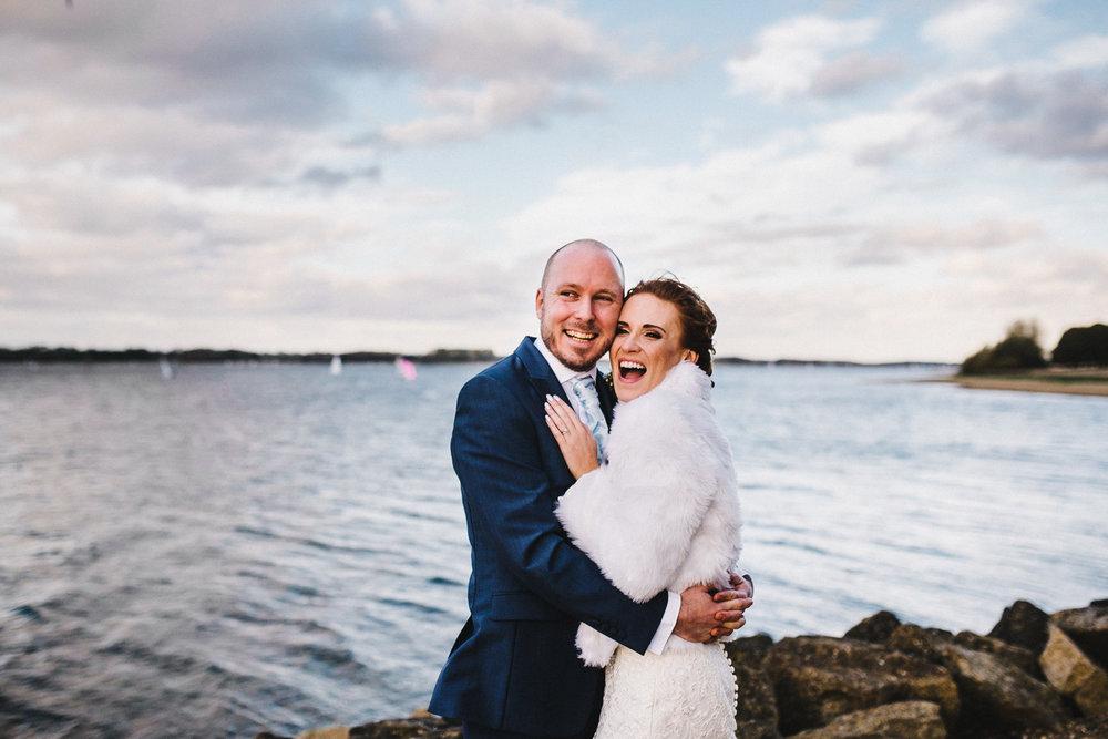 laughing-bride-and-groom-rutland-water.jpg
