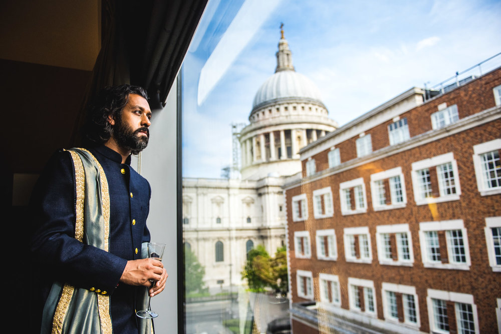 indian-groom-looks-out-at-st-pauls-london.jpg