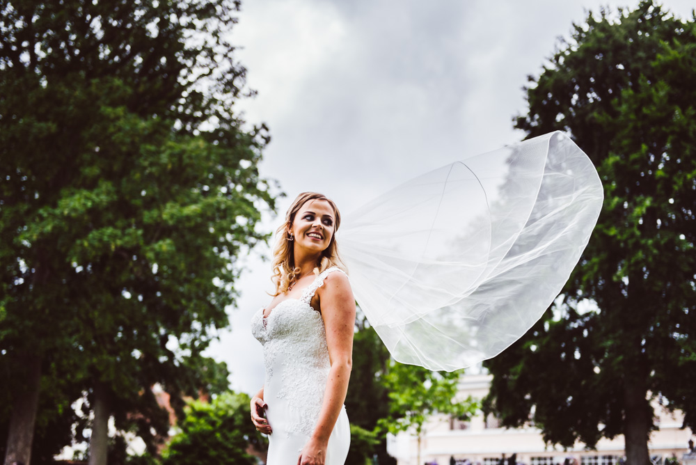 brides veil blows in the wind at henley on thames