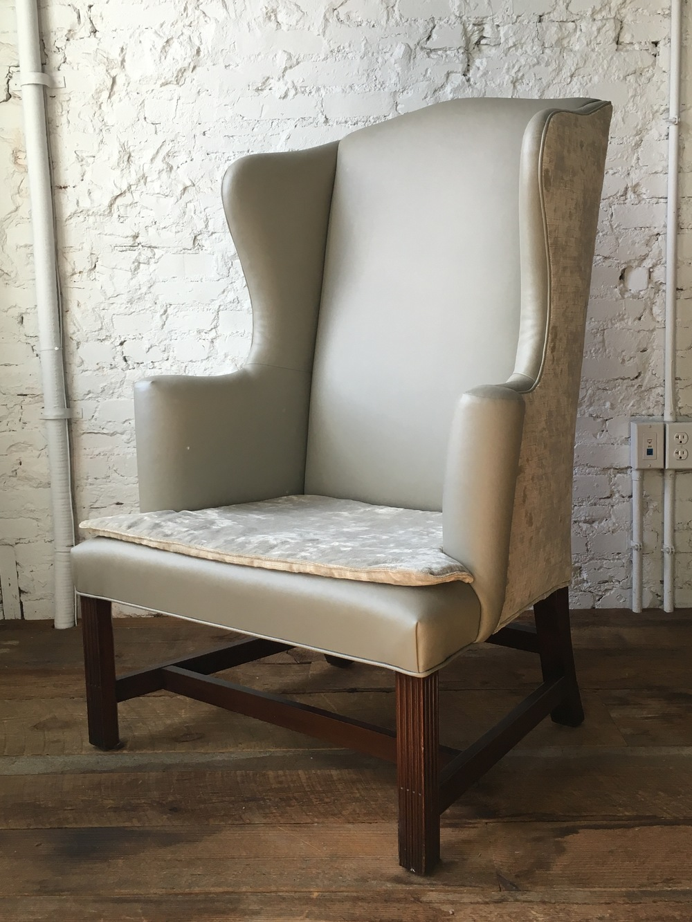 WING CHAIR IN LEATHER AND SHEARED VELVET. DARRYL CARTER BOUTIQUE. WASHINGTON DC.