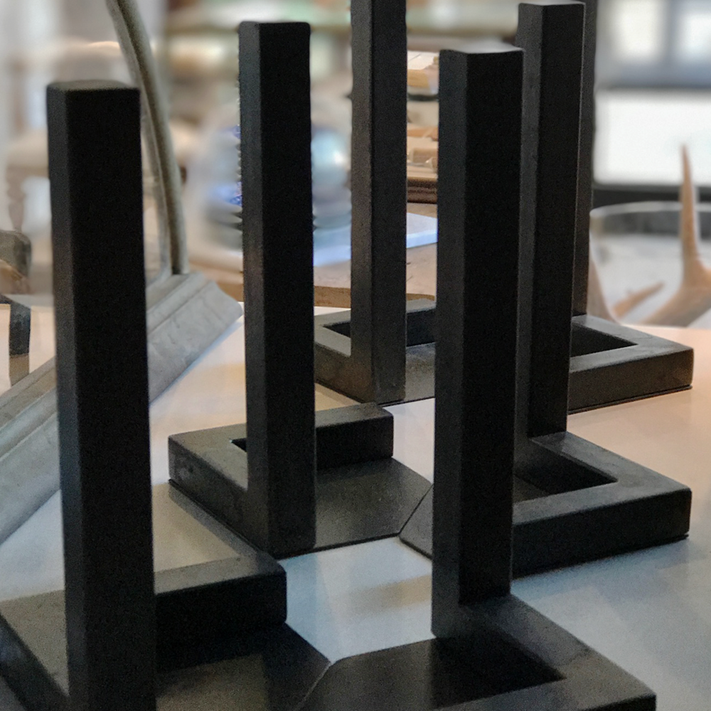 "Iron Forged ""L"" Book Stands, Pair   4.5""L x 4.5"" D x9"" H  $220   To order please call us at 202-234-5926 or email at boutique@darrylcarter.com. Please note pricing excludes taxes and shipping."
