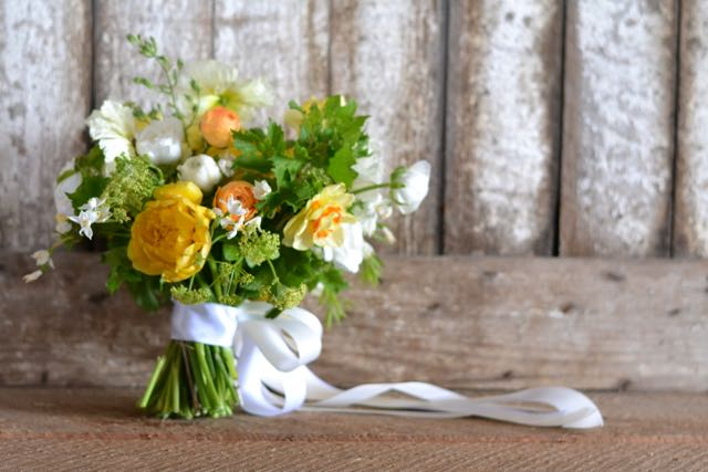 I snatched up the gorgeous double yellow tulips to make this spring flower infused bridal bouquet