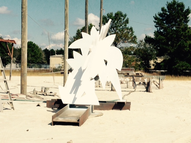 "A commissioned steel sculpture, entitled ""Onward"", gets a fresh coat of paint before its installation in Bay St. Louis, MS."