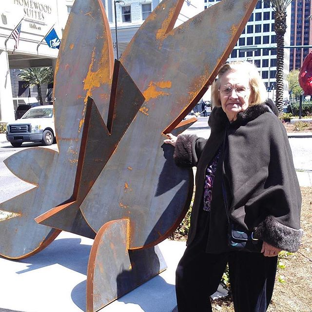 "Abuelita and ""Swamp Flower"", 2013. She loved it at first sight, didn't quite understand why we were standing there in the middle of Poydras and when I explained to her that I was the artist behind the sculpture, the look on her face was priceless, like ""what?!?!?!"". She has short-term memory loss, but she has it imprinted that I'm an artist. She forgets what my work looks like, so I love that she is drawn to it without knowing. I feel like that's what art should do. It draws you in, makes you wonder, confuses, enlightens. It doesn't provide all the answers at once. There is no instant gratification in practicing visual art, just moments like this when everything feels in alignment."