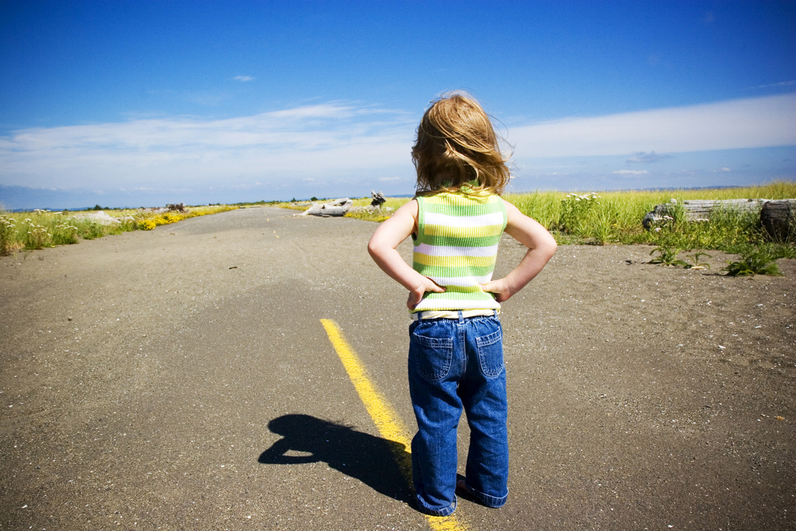 Little Girl Standing in the Middle of the Road