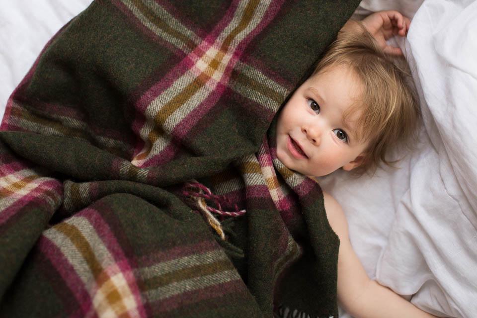 Tartan blanket and child Scotland