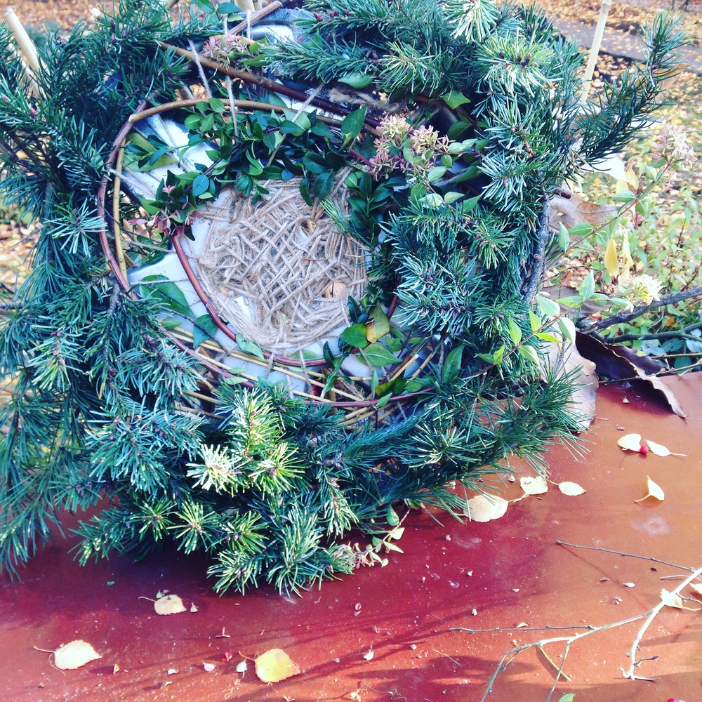 Some rims at the side of the road, and a few fallen branches of evergreen inspired this holiday wreath.