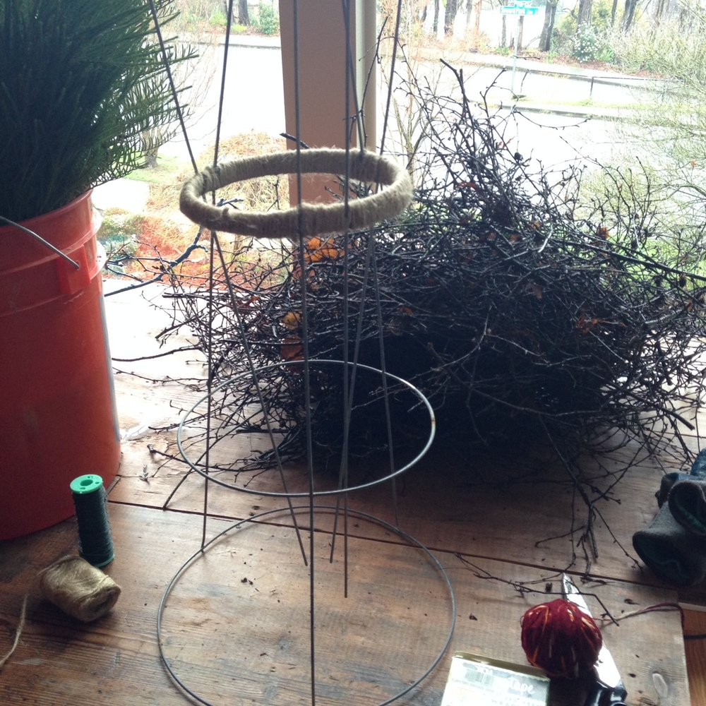 Twigs and brush gathered after a major windstorm come in handy for this fun plant-sculpture DIY.