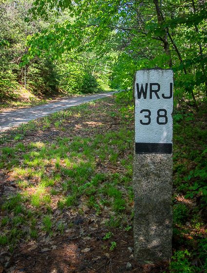 Look for historic mileposts – this one showing that it's 38 miles to White River Junction; the backside would show the distance to Boston