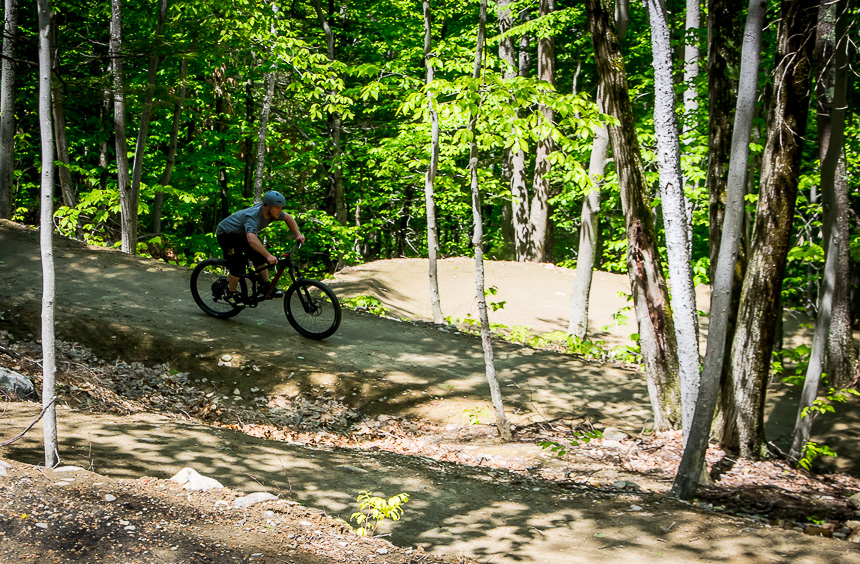 Practice riding banked curves on the Highland Mountain bike trails