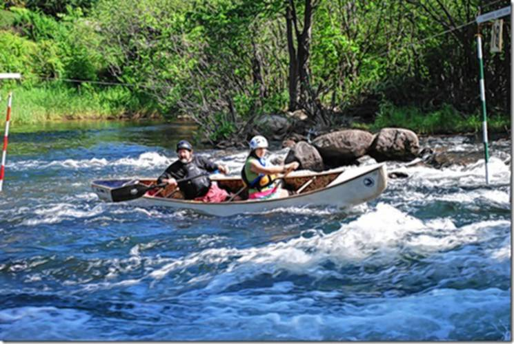 Race directors Sonny and Amy Hunt take part in a previous year's slalom race on the Winnipesaukee River. Concord Monitor Article Picture.