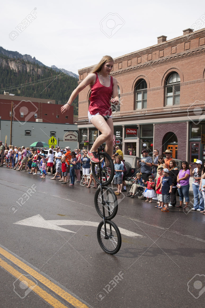 24619472-Unicyclist-bicycles-in-July-4-Independence-Day-Parade-Ouray-Colorado--Stock-Photo.jpg