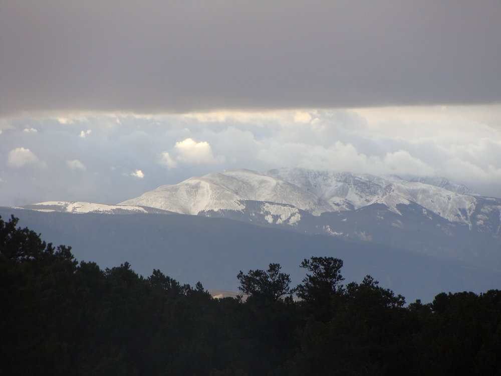 Snow on the Peaks and a Morning Glimpse of the Great Sand Dunes just above the treetops.