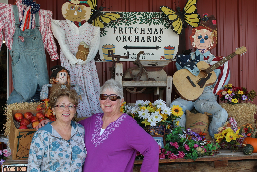 Sharon and Darlene of Fritchman Orchards pose outside their store front.