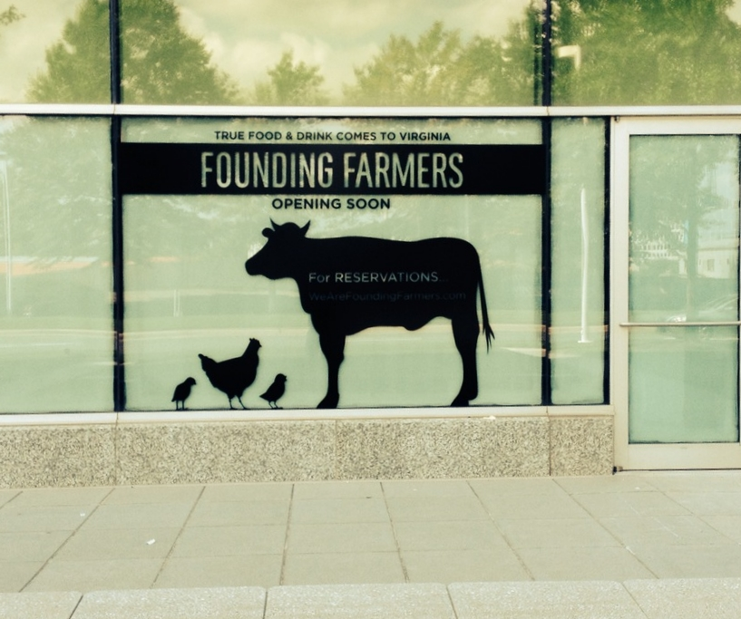 Temporary black vinyl window application for Founding Farmers