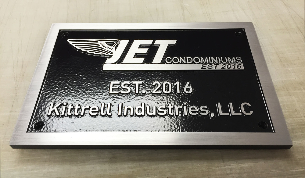 "Plaque: 1/4"" thick solid brushed aluminum. Painted black, leatherette texture"