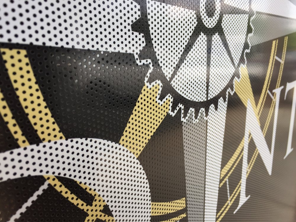 Close-up of the printed surface of the perforated vinyl.