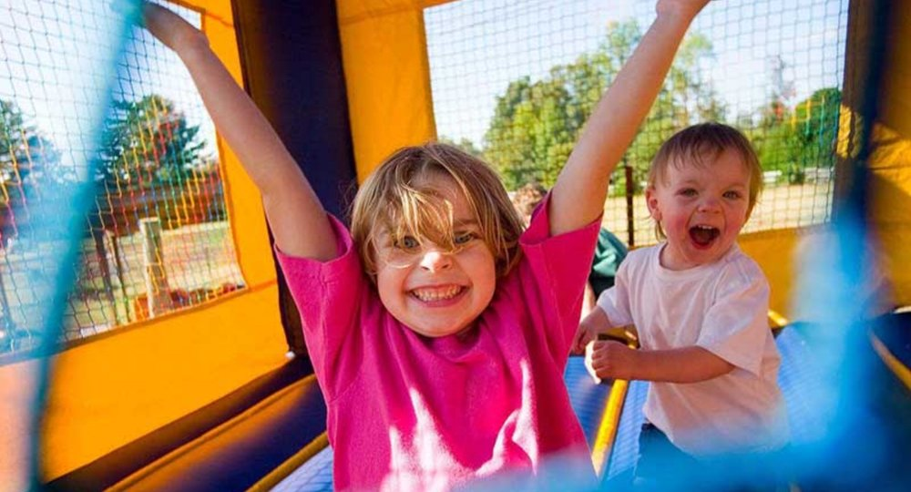 kids-jumping-in-bounce-house.jpg
