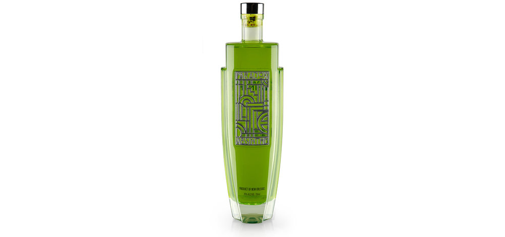 Paradox Absinthe is inspired by the Art Deco Architecture and Speakeasies of the 20s which are expressed both in the overall structure of the bottle as well as in the geometric pattern of the central panel. The graphics are 3D in nature and are embodied by a metalized inlay that brings further textural definition to the holistic form, a beacon of structural and graphic harmonization. The bottle is weighted high to evoke exclusivity and confidence as well as mirror the higher level of awareness and sensory experience often connected with the spirit of Absinthe. The positive and negative space, along with the reflective quality of the chrome inlay, provide a feast for the eyes that gets more decadent with each and every glance.
