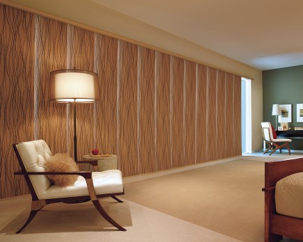 4. Skyline Gliding Panels - Pros:  600+ fabric choices that coordinate seamlessly with designer roller and sunscreen shades.  Sleek, modern and makes for a unique room divider.Cons:  Requires 18+ inches to stack completely off window.  Consideration to be taken at time of measure as some fabrics may stretch. See more info on Skyline Gliding Panels
